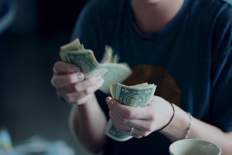 Woman counts US dollar bills