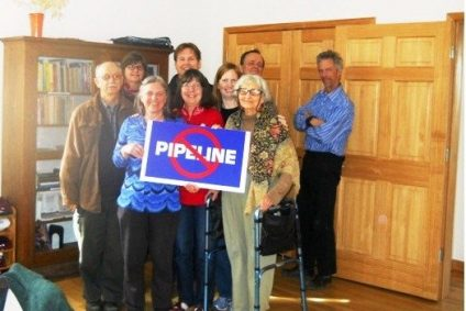 """Group standing with """"No Pipeline"""" Sign"""