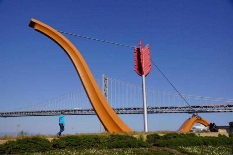 Yellow sculpture in front of blue sky