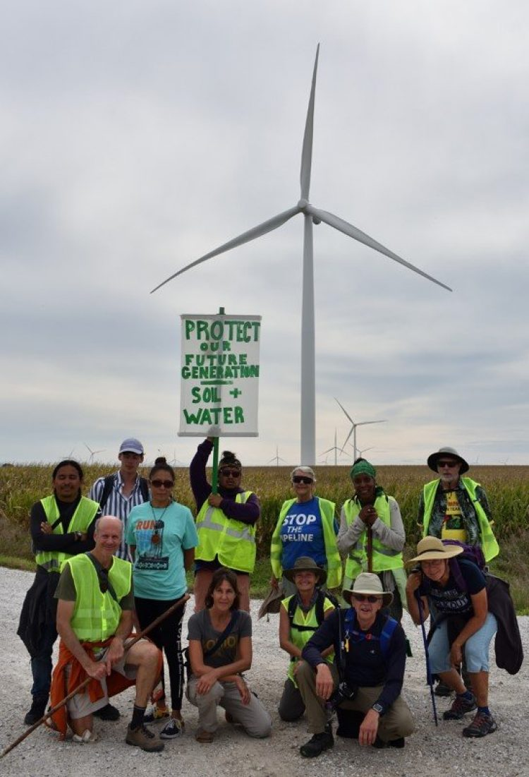 First Nation - Farmer Climate Participants standing in front of wind turbine