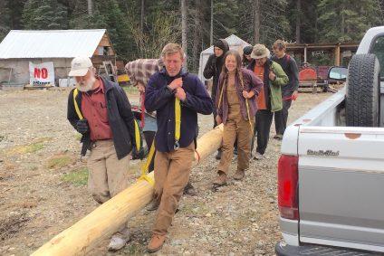Group of people hawl log