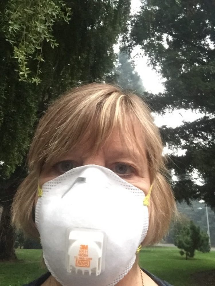 A woman in a N95 face mask