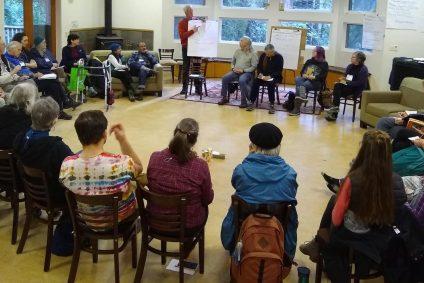 Group sitting in circle at Ben Lomond Quaker Center