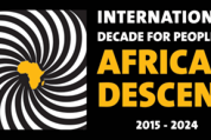 """Black background with small image of Africa in yellow with white stripes around it and """"International Decade for People of African Descent"""" on right"""