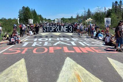 Treaty People Gathering Chalk Sign on Bridge